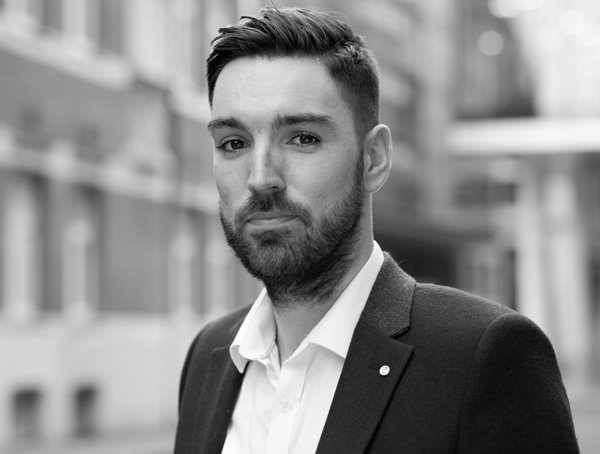 jamie ellwood black and white team image in portrait mode to promote sustainability consulting